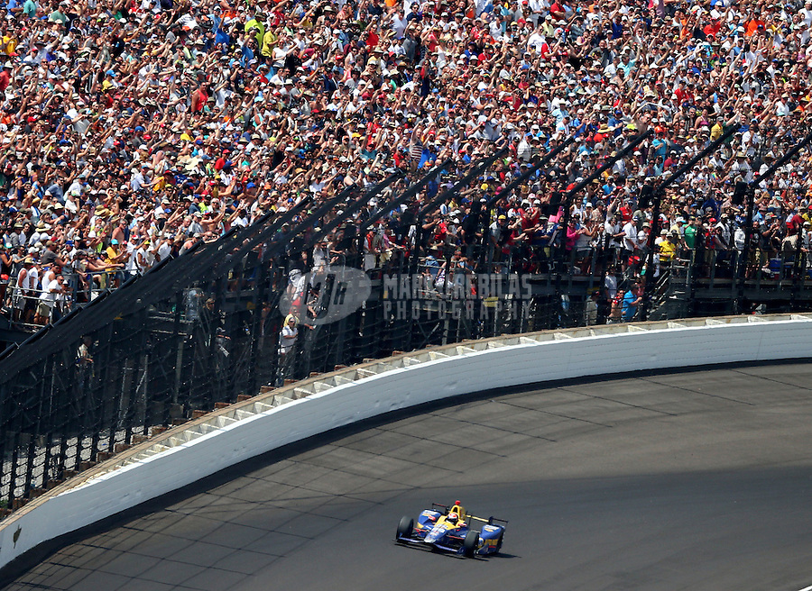 May 29, 2016; Indianapolis, IN, USA; IndyCar Series driver Alexander Rossi coasts through turn four on the final lap of the 100th running of the Indianapolis 500 at Indianapolis Motor Speedway. Mandatory Credit: Mark J. Rebilas-USA TODAY Sports