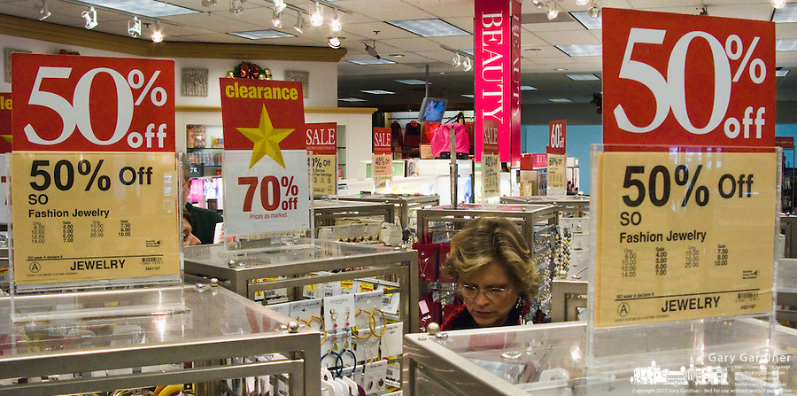 Customers look over last minute jewelry bargains the weekend before Christmas..