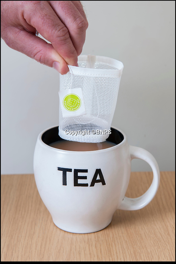 BNPS.co.uk (01202 558833)<br /> Pic: PhilYeomans/BNPS<br /> <br /> Finally...An end to the Tea-break terror...<br /> <br /> First drop in the 'Cookie catcher'..<br /> <br /> Tea drinkers are rejoicing after a nifty device designed to catch crumbs left by dunking biscuits in your brew hit the shelves.<br /> <br /> Dad of two Andrew Tinsley solved the age-old problem with a canny mesh pouch which sits inside a mug of tea collecting any unwanted biscuit bits that might float off during dunking.<br /> <br /> And should your Digestive or Rich Tea become too soggy and break off altogether this cheap and cheerful gadget will guarantee drinkers are not left with a heap of biscuity sludge at the bottom of their cup.<br /> <br /> Entrepreneur Andrew, 49, dreamed up the product, called the Cookie Catcher, after watching family members lose their sodden biscuits in their tea after dunking them for too long during Christmas celebrations last year.