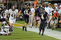 25 October 2011:  FIU wide receiver T.Y. Hilton (4) breaks into the secondary in the first half as the FIU Golden Panthers defeated the Troy University Trojans, 23-20 in overtime, at FIU Stadium in Miami, Florida.