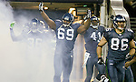 Seattle Seahawks defensive tackle Clinton McDonald (69), cornerback  Byron Maxwell (41) and cornerback Ron Parker (36)  hypes up the crowd before kickoff against the St. Louis Rams at  CenturyLink Field in Seattle, Washington on December 12, 2011. The Seahawks beat the Rams 30-13. ©2011 Jim Bryant Photo. All Rights Reserved.