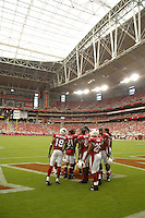 Aug 18, 2007; Glendale, AZ, USA; Arizona Cardinals players huddle up prior to the game against the Houston Texans at University of Phoenix Stadium. Mandatory Credit: Mark J. Rebilas-US PRESSWIRE Copyright © 2007 Mark J. Rebilas