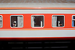 21 December 2005: Two men eat their lunch on a train passing through the railway station in Tianjing, China. (Photo by Tony Ding)