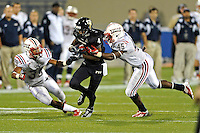 12 November 2011:  FIU wide receiver T.Y. Hilton (4) attempts to evade Florida Atlantic defensive back Christen Milstead (39) and linebacker Andrae Kirk (45) after a reception in the third quarter as the FIU Golden Panthers defeated the Florida Atlantic University Owls, 41-7, to win the annual Shula Bowl game, at FIU Stadium in Miami, Florida.