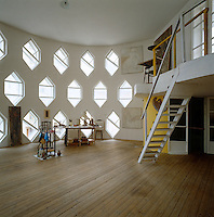 A view of the atelier's mezzanine with the floor-to-ceiling honeycomb windows in the background