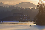 Seattle, Lake Washington, Cascade Mountains, 520 Bridge, sunrise, rowers, morning workout, single sculler, Washington State, Pacific Northwest, USA, Autumn,