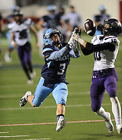 NWA Democrat-Gazette/ANDY SHUPE<br /> Andrew Ellis (10) of Fayetteville and Dalton Douangdara (3) of Har-Ber reach for a pass Saturday, Dec. 5, 2015, during the first half of the Class 7A state championship game at War Memorial Stadium in Little Rock. Visit nwadg.com/photos to see more photographs from the game.