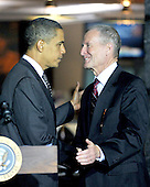 McLean, VA - October 6, 2009 -- United States President Barack Obama, left, shakes hands with Dennis Blair, Director of National Intelligence, right, after making remarks during a visit to the National Counterterrorism Center (NCTC) in McLean, VA on Tuesday, October 6, 2009..Credit: Ron Sachs / Pool via CNP