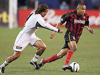 Ricardo Clark of the MetroStars is marked by Oscar Pareja of the Burn. The Dallas Burn were defeated by the NY/NJ MetroStars 2-1 on 5/24/03 at Giant's Stadium, East Rutherford, NJ.