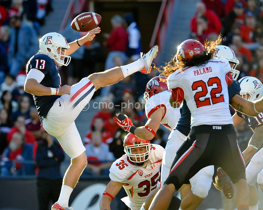 Nov 5, 2011; Tucson, AZ, USA; Arizona Wildcats punter Kyle Dugandzic (13) has his punt blocked in the first quarter of a game against the Utah Utes at Arizona Stadium.