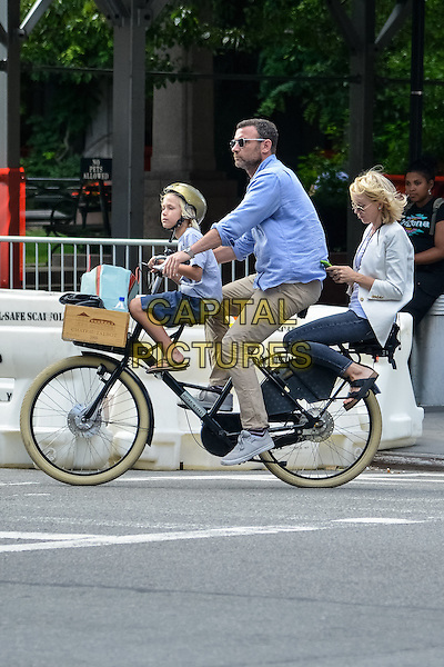 NEW YORK, NY - JULY 22: Naomi Watts and Liev Schreiber and their son Samuel seen riding a bike in New York City on July 22, 2015. <br /> CAP/MPI67<br /> &copy;MPI67I/Capital Pictures