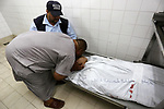 Relatives of Palestinian teenager Belal Khafaja, who was killed by Israeli forces during clashes in tents protest at the Israel-Gaza border, mourn over his body at a hospital in Rafah in the southern Gaza Strip on September 7, 2018. Photo by Ashraf Amra