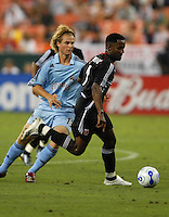DC United forward Luciano Emilio (11) shields the ball from Colorado Rapids defender Stephen Keel (13). DC United defeated Colorado Rapids 4-1, at RFK Stadium in Washington DC, Thursday, June 28, 2007.