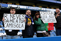 Some overseas fans from Portugal hold up banners for the attention of Wolverhampton Wanderers Ruben Neves during Chelsea vs Wolverhampton Wanderers, Premier League Football at Stamford Bridge on 10th March 2019