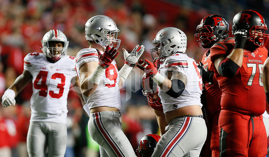 Ohio State Buckeyes defensive lineman Joey Bosa (97) reacts after sacking Rutgers Scarlet Knights quarterback Chris Laviano (5) the college football game between the Rutgers Scarlet Knights and the Ohio State Buckeyes at High Point Solutions Stadium in Piscataway, NJ, Saturday night, October 24, 2015. The Ohio State Buckeyes defeated the Rutgers Scarlet Knights 49 - 7. (The Columbus Dispatch / Eamon Queeney)