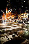 Night scene in New York with traffic at junction and people crossing road