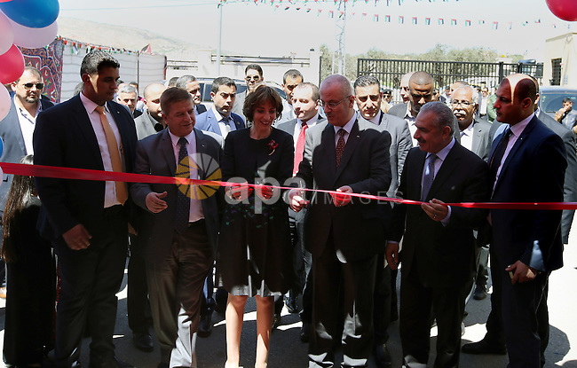 Palestinian Prime Minister, Rami Hamdallah, attends the inauguration ceremony of the Central Medical Stores, funded by the French Development Agency, in the West Bank city of Nablus, on April 2, 2016. Photo by Prime Minister Office