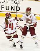 Meagan Mangene (BC - 24) and Kelli Stack (BC - 16) celebrate Stack's goal. - The Boston College Eagles defeated the visiting University of Connecticut Huskies 3-0 on Sunday, October 31, 2010, at Conte Forum in Chestnut Hill, Massachusetts.