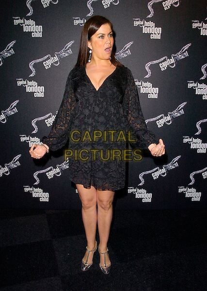 "AMANDA LAMB.Attending ""Capital Rocks"" at Battersea Evolution, .London, England, December 11th 2007..full length  black dress funny.CAP/CAN.©Can Nguyen/Capital Pictures"