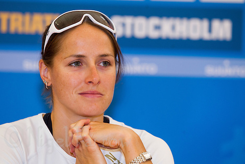24 AUG 2012 - STOCKHOLM, SWE - Erin Densham (AUS) of Australia listens to a question during the 2012 ITU World Triathlon Series pre race press conference in Gamla Stan, Stockholm, Sweden .(PHOTO (C) 2012 NIGEL FARROW)