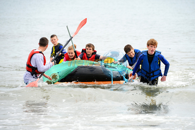 Alanna McDonagh, Jack Snaith, Cal McKenna, Corrie Boyd, Ben Keogh and Aaron McGreavy adopt the push me, pull me technique to get their raft over the finishing line of the Clogherhead Raft Race. www.newsfile.ie www.newsfile.ie www.newsfile.ie