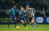 Jonathan Stead of Notts Co & Michael Harriman of Wycombe Wanderers chase the ball during the Sky Bet League 2 match between Notts County and Wycombe Wanderers at Meadow Lane, Nottingham, England on 10 December 2016. Photo by Andy Rowland.