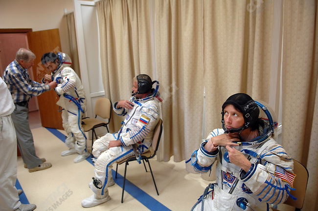 In a dressing room of one of the training centres of Star City, the Russian space training centre outside of Moscow, Shannon Walker, an American astronaut, back up crew for an upcoming Soyuz and ISS mission (R), Maxim Suraev, a Russian cosmonaut and back up crew for an upcoming Soyuz and ISS mission(C) , and Koichi Wakata, a Japanese astronaut, Shuttle Rotating Expedition Crew (L), suited up before going into a Soyuz vehicle mock-up to run through a practice of a flight descent phase. Star City, Russia, June 23, 2008.