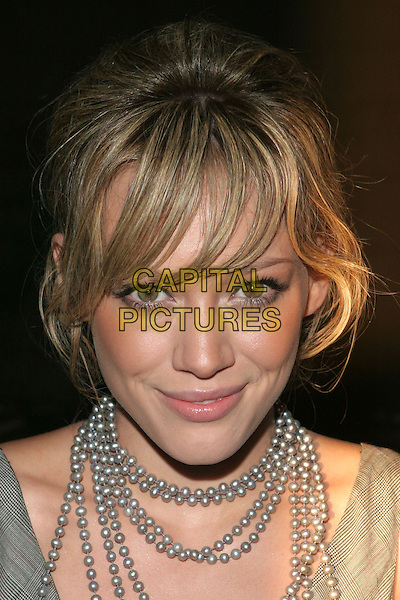 "HILARY DUFF.Teen Vogue Celebrates ""Young Hollywood Issue"" held at the Hollywood Roosevelt Hotel,.Los Angeles, 20thn September 2005.portrait headshot  grey gray dress silver beads necklace.Ref"" ADM/ZL.www.capitalpictures.com.sales@capitalpictures.com.© Capital Pictures."