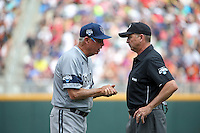 Head coach Mike Gillespie of the UC Irvine Anteaters argues a call during Game 1 of the 2014 Men's College World Series between the UC Irvine Anteaters and Texas Longhorns at TD Ameritrade Park on June 14, 2014 in Omaha, Nebraska. (Brace Hemmelgarn/Four Seam Images)