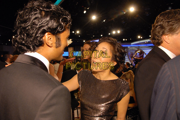 "SENDHIL RAMAMURTHY & SANDRA OH.Telecast - 64th Annual Golden Globe Awards, Beverly Hills HIlton, Beverly Hills, California, USA..January 15th 2007. .globes half length back behinf jennifer garner in backfround.CAP/AW.Please use accompanying story.Supplied by Capital Pictures.© HFPA"" and ""64th Golden Globe Awards"""