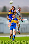 St Mary's Bryan Sheehan showed his dominance in the air as he fists this ball away from his opposite number Nicolas Murphy for Carrigaline.