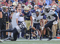 Annapolis, MD - October 21, 2017: Navy Midshipmen running back Malcolm Perry (10) gets tackled by UCF Knights defensive back Kyle Gibson (25) during the game between UCF and Navy at  Navy-Marine Corps Memorial Stadium in Annapolis, MD.   (Photo by Elliott Brown/Media Images International)