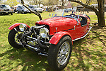 Floral Park, New York, U.S. - April 27, 2014 - A red BRA CX3, a custom Beribo Replica Automobiles kit vehicle with three wheels, and registered by DMV as a 2009 Custom Motorcycle, is exhibited at the 35th Annual Antique Auto Show at Queens Farm.
