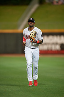 Birmingham Barons center fielder Luis Robert (26) jogs to the dugout during a Southern League game against the Chattanooga Lookouts on May 1, 2019 at Regions Field in Birmingham, Alabama.  Chattanooga defeated Birmingham 5-0.  (Mike Janes/Four Seam Images)