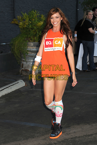 JESSICA SUTTA .The Ultimate Slam Paddle Jam 2010 Celebrity Ping Pong Tournament held at the Music Box Theatre,  Hollywood, California, USA, 26th September 2010..full length orange top socks trainers shorts .CAP/ADM/BP.©Byron Purvis/AdMedia/Capital Pictures.