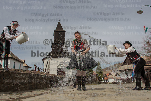 """Girls run as boys throw water at them as part of traditional Easter celebrations, during a media presentation in Holloko, 100 km (62 miles) east of Budapest, Hungary on March 28, 2012..Locals from the World Heritage village of Holloko, celebrate Easter with the traditional """"watering of the girls"""", a Hungarian tribal fertility ritual rooted in the area's pre-Christian past. ATTILA VOLGYI"""