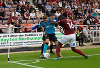 Wes Burns of Fleetwood Town and Aaron Pierre of Northampton Town during the Sky Bet League 1 match between Northampton Town and Fleetwood Town at Sixfields Stadium, Northampton, England on 12 August 2017. Photo by Alan  Stanford / PRiME Media Images.
