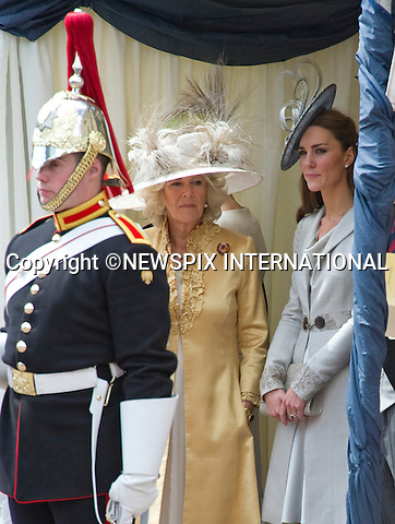 "CATHERINE, DUCHESS OF CAMBRIDGE ATTENDS GARTER SERVICE.Kate joined husband Prince William and other members of the Royal Family for the 1st Garter Service at Windsor Castle, Windsor_13/06/2011.Picture Show: Catherine with Camilla, Duchess of Cornwall.Mandatory Photo Credit: ©NEWSPIX INTERNATIONAL..**ALL FEES PAYABLE TO: ""NEWSPIX INTERNATIONAL""**..PHOTO CREDIT MANDATORY!!: NEWSPIX INTERNATIONAL(Failure to credit will incur a surcharge of 100% of reproduction fees)..IMMEDIATE CONFIRMATION OF USAGE REQUIRED:.Newspix International, 31 Chinnery Hill, Bishop's Stortford, ENGLAND CM23 3PS.Tel:+441279 324672  ; Fax: +441279656877.Mobile:  0777568 1153.e-mail: info@newspixinternational.co.uk"