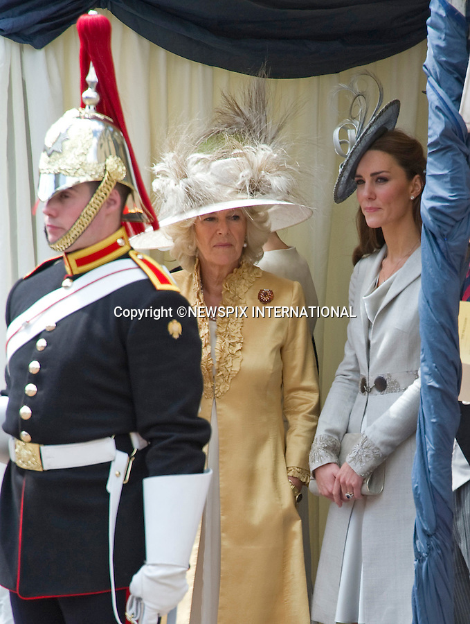 """CATHERINE, DUCHESS OF CAMBRIDGE ATTENDS GARTER SERVICE.Kate joined husband Prince William and other members of the Royal Family for the 1st Garter Service at Windsor Castle, Windsor_13/06/2011.Picture Show: Catherine with Camilla, Duchess of Cornwall.Mandatory Photo Credit: ©NEWSPIX INTERNATIONAL..**ALL FEES PAYABLE TO: """"NEWSPIX INTERNATIONAL""""**..PHOTO CREDIT MANDATORY!!: NEWSPIX INTERNATIONAL(Failure to credit will incur a surcharge of 100% of reproduction fees)..IMMEDIATE CONFIRMATION OF USAGE REQUIRED:.Newspix International, 31 Chinnery Hill, Bishop's Stortford, ENGLAND CM23 3PS.Tel:+441279 324672  ; Fax: +441279656877.Mobile:  0777568 1153.e-mail: info@newspixinternational.co.uk"""