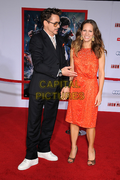 """Susan Levin & Robert Downey Jr..""""Iron Man 3"""" World Premiere held at the El Capitan Theatre, Hollywood, California, USA..April 24th, 2013.full length dress red orange beads beaded black suit waistcoat glasses tinted married husband wife beard facial hair hand arm profile .CAP/ADM/BP.©Byron Purvis/AdMedia/Capital Pictures"""