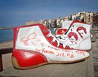Cefal&ugrave;: creazioni di Francesco Libero, alias Ciccio, il calzolaio della formula uno, iscritto dall&rsquo;UNESCO fra i Tesori Umani Viventi nel Libro dei Saperi del Registro delle Eredit&agrave; Immateriali.<br /> Cefal&ugrave;: shoes created by Ciccio , Ciccio, whose real name is Francesco Liberto , registered with the UNESCO Living Human Treasures in the Book of Knowledge of the Register of Intangible Heritage, has been for several years the shoemaker of the racing drivers of Formula 1