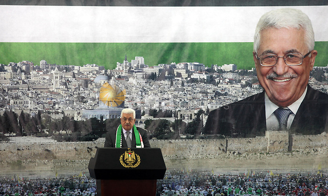 Palestinian President Mahmud Abbas delivers a speech to mark the eighth anniversary of the death of the late leader Yasser Arafat, in the West Bank city of Ramallah on November 11, 2012. Palestinians are coordinating with Russia, as well as Swiss and French experts, on the exhumation of Arafat who died in a French military hospital near Paris on November 11, 2004, and who French experts were unable to say what had killed him. Many Palestinians are convinced he was poisoned. In the background is an image of Jerusalem's Dome of the Rock in the al-Aqsa compound, Islam's third most holiest site. Photo by Issam Rimawi