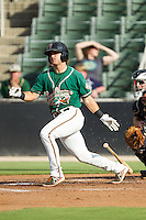 Avery Romero (1) of the Greensboro Grasshoppers follows through on his swing against the Kannapolis Intimidators at CMC-NorthEast Stadium on August 31, 2014 in Kannapolis, North Carolina.  The Grasshoppers defeated the Intimidators 3-1.  (Brian Westerholt/Four Seam Images)