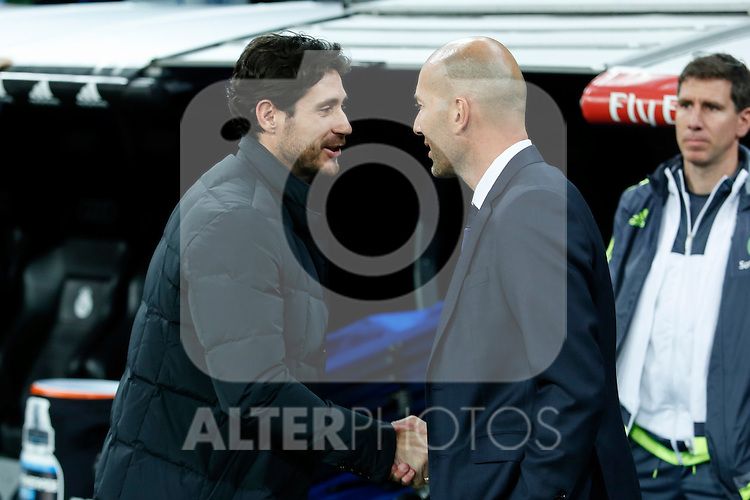 Real Madrid´s new coach Zinedine Zidane greets coach Victor Sanchez before 2015/16 La Liga match between Real Madrid and Deportivo de la Coruna at Santiago Bernabeu stadium in Madrid, Spain. January 09, 2015. (ALTERPHOTOS/Victor Blanco)