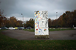 A solitary section of the former Berlin Wall on display in a park in Neukölln. The route of the Wall, which stood from 1961-1989, has been developed into the 'Mauerweg,' a thoroughfare which traces most of the route of the Wall which encircled the city and divided it into East and West Berlin during the Cold War. In the years following the 1989 civil uprising in the German Democratic.Republic, most of the Wall was removed as part of the reunification strategy which united the pro-Soviet DDR and the Federal Republic of (West) Germany.