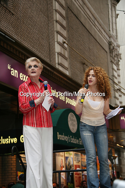 """Bernadette Peters and Blithe Spirit's Angela Lansbury at Broadway Barks 11 - a """"Pawpular"""" star-studded dog and cat adopt-a-thon on July 11, 2009 in Shubert Alley, New York City, NY. (Photo by Sue Coflin/Max Photos)"""