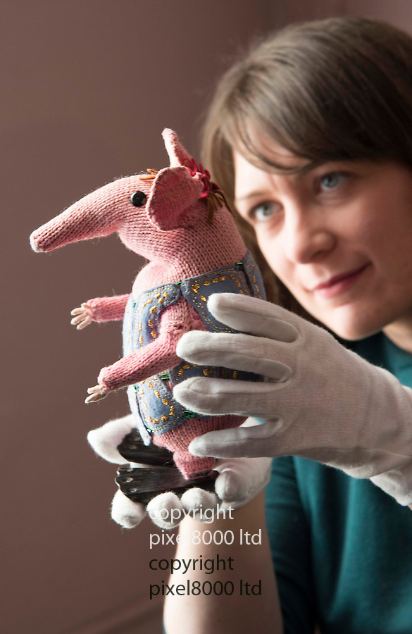 Pic shows:  Museum staff holds The Clangers<br /> <br /> <br /> Bagpuss and Clangers <br /> New exhibition at V&amp;A Museum of Childhood, London<br /> <br /> Created by Oliver Postgate at Peter Firmin of Smallfilms<br /> <br /> <br /> <br /> <br /> Pic by Gavin Rodgers/Pixel 8000 Ltd