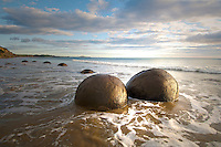 Photo of Moeraki Boulders early morning | waves | Blue sky | clouds | Otago New Zealand