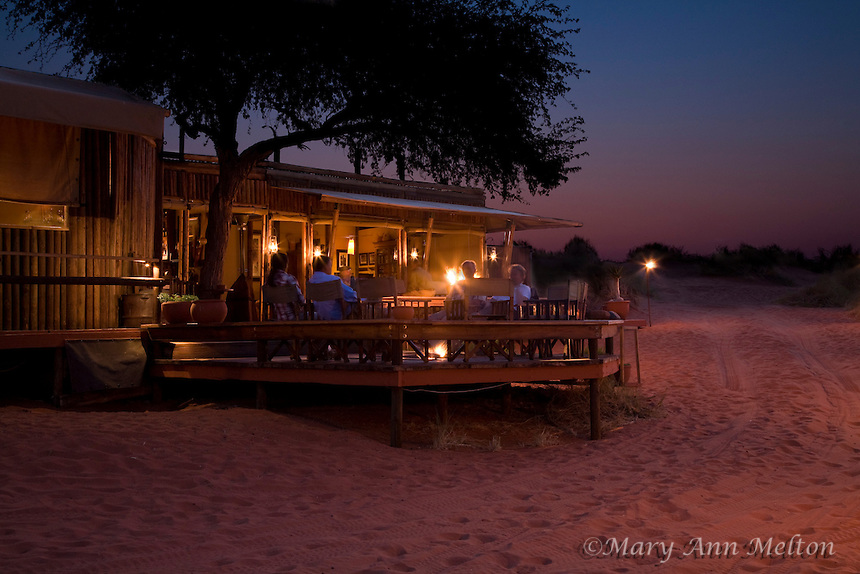 Evening at Wolwedans Dune Camp - After a safari in the Namib-Rand Preserve, guests unwind by the fire.