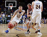 SIOUX FALLS, SD: MARCH 5: Michael Orris #50 from South Dakota State University drives to the basket against Denver during the Summit League Basketball Championship on March 5, 2017 at the Denny Sanford Premier Center in Sioux Falls, SD. (Photo by Dave Eggen/Inertia)